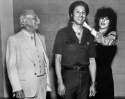 In 1978, the year before the SeattleSuperSonics won the national NBA championship, Fox's Gem Shop made custom medallions for the entire Sonics team. Here, Joy Thal Mann (right) hangs a medallion on Sonics coach Lenny Wilkens while Sidney Thal (left) watches.