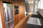 The kitchen of Method Homes' custom manufactured home in Seattle features custom black walnut cabinets, precast concrete countertops and strand-woven bamboo flooring from Bamboo Hardwoods.
