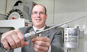 Bob Overmars, president and CEO of Double Drive Medical Inc., holds a prototype of the Double Drive Medical Screwdriver.  He's standing in the Fife manufacturing facility of one of his other companies, BPI Medical, where the prototype was created.