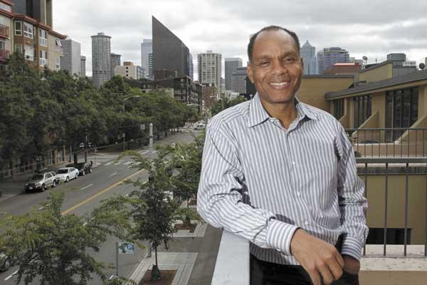 Reggie Brown, CEO of All Property Management, on the balcony of the company's new offices in Seattle's Belltown neighborhood.