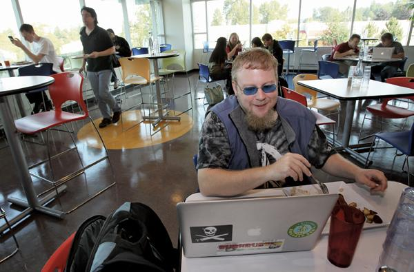 Joe Muharsky, a Google test engineer, enjoys lunch at the Sudo Cafe at Google's offices in Kirkland. Google provides three free meals a day plus a nearly unlimited array of snacks. In fact, the company has a rule: No one's desk can be more than 150 feet from food.