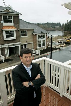 Developer Claudio Guincher, at his Lake Boren Townhomes in Newcastle