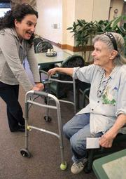 Rehab outpatient Doris Coffman (right) chats with recreation therapist Susan Disman during a day visit at Providence Mount St. Vincent in West Seattle.