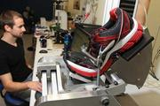 Brooks Sports biomechanist Stacy Steffen flex-tests a Brooks Glycerin 10 shoe in the Brooks Human Performance Lab. The Glycerin 10 will be released in June.