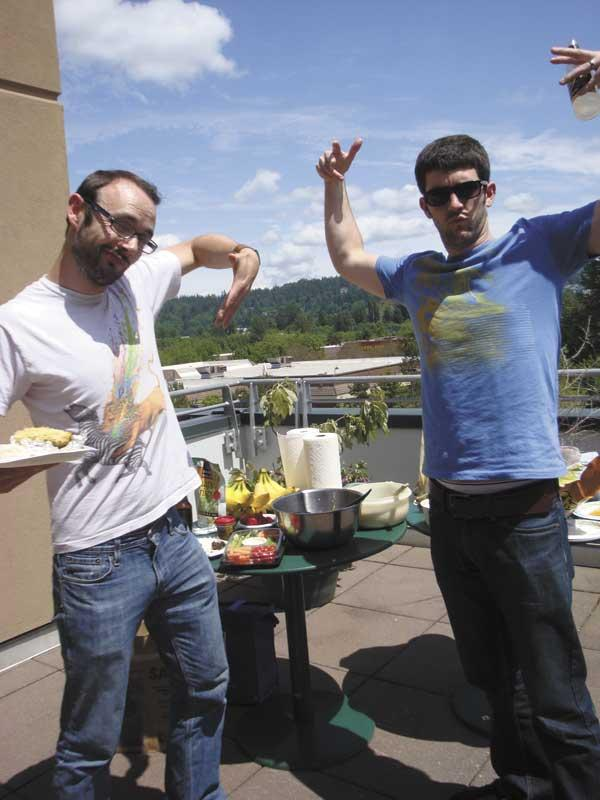 Shane O'Sullivan, left, and Greg Flowers blow off steam at an Artitudes Design rooftop barbecue.