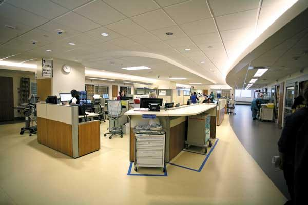 In the new emergency department at Virginia Mason Medical Center in Seattle, nurses and doctors are located in the center and treatment rooms are along the outside. This layout allows for visual line-of-sight control.