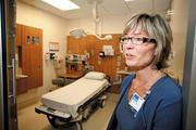 Karen Gifford, administrative director of hospital operations at Virginia Mason Medical Center, inspects one of the patient rooms in the new Emergency Department. Every  treatment room is laid out exactly the same way to improve efficiency.