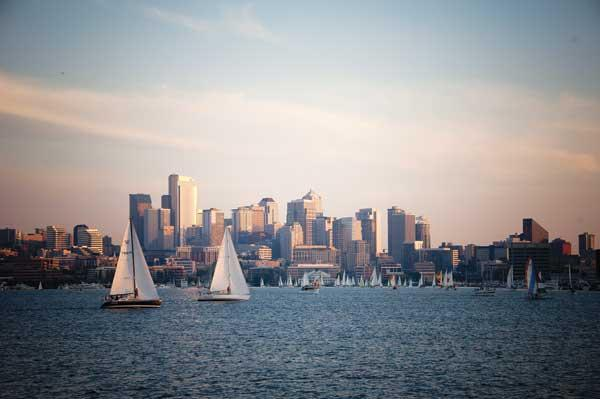Sails dominate the Lake Union scene on summer evenings, but sailboats are  often joined by foot ferries, kayaks, canoes, and even a floating hot tub as options multiply for water recreation.