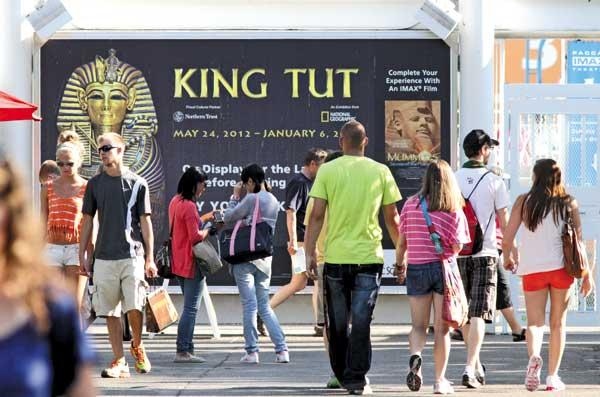 Crowds at Seattle Center bunch around the entrance to a King Tut exhibit at the Pacific Science Center, for which some 355,000 tickets have been sold. New attractions and an improving economy have made for the best local tourist season in years.