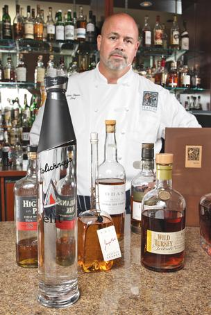 John Howie, chef and owner of four restaurants, says it's not uncommon under Washington's state-run liquor distribution system to wait weeks or months for certain brands, such as these pictured at his Bellevue Seastar bar.