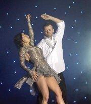 Laura Lohman, principal of the Seneca Group, and professional dancer Joshua Sturgeon won for their slow swing.