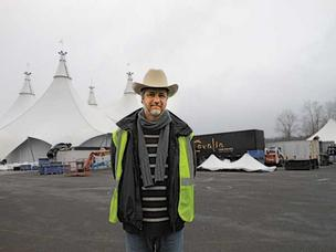 "Marc Beaudry, tour director for the show ""Cavalia: A Magical Encounter between Human and Horse,"" stands in front of the production's tents that are going up at Marymoor Park."
