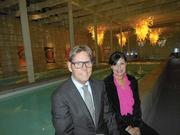 Larry Winn (left) and Pat Wallace, co-chairs of the Transplant House auction, enjoy the pool room at the Chihuly Boathouse