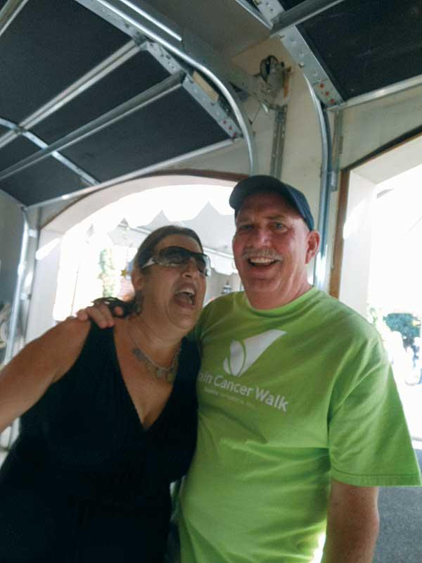 DANCE WITH ME: SaSa Kirkpatrick (left) and her husband Ken Kirkpatrick, sweethearts since high school, party in their garage.