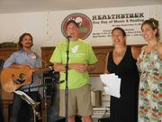 GRATITUDE: Members of the Kirkpatrick family address the estimated 150 people who attended a music festival at their home. They are, from left, Michael Kirkpatrick, Ken Kirkpatrick, SaSa Kirkpatrick and Tina Kirkpatrick.