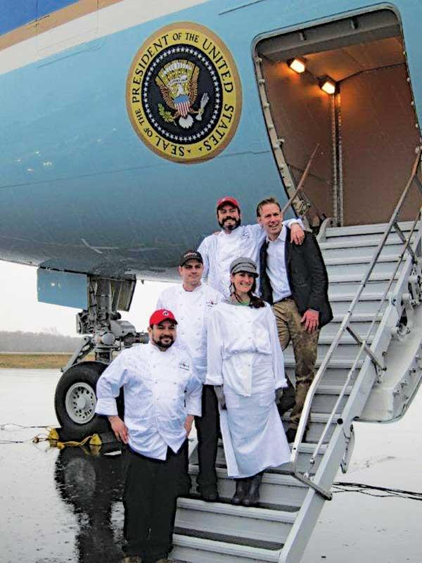 Tutta Bella team members, from top left, Executive Chef Brian Gojdics, founder Joe Fugere, Dan Piecora Jr., Emily Resling and Michael Cisneros on the steps of Air Force One at Paine Field, in Everett.