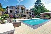 After failing to sell their new Mercer Island mansion for $28.8 million, owners David and Becky Sandwith have shaved the price 34 percent to $18.95 million.
