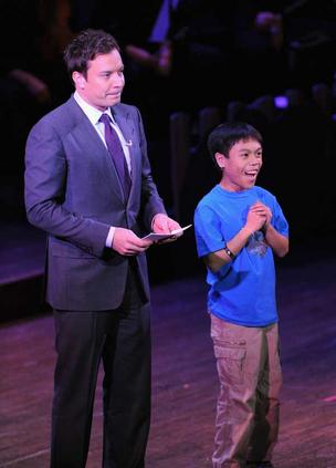 "Comedian Jimmy Fallon (left) and Washington state teenager Alfred ""Alfie"" Bautista, 13, entertain the audience at a benefit event for the SeriousFun Children's Network in New York."