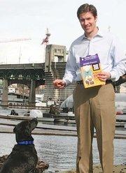 Blue Dog Bakery CEO Kyle Polanski poses with Havana, the company's chief treat tester.