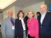 """On hand for the arrival of the """"Super Guppy"""" were, from left, former Gov. Mike Lowry, astronaut and former Museum of Flight CEO Bonnie Dunbar, Gov. Chris Gregoire and former Gov. Dan Evans."""