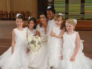 Flower girls pose with bride Effie True before the wedding ceremony. They are, from left, Kelly Gleason, Shea Gleason, True, Emiko Skerritt, Anne Riley and Cecilia Clark.
