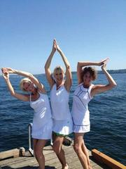 A portfolio manager, a business owner and an attorney played Esther Williams for a moment before plunging into Lake Washington in their tennis whites after playing the game on a hot day. Getting ready to take the plunge are, from left, Diane Daggatt, Kari Anderson and Jan Waszak.