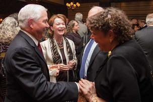 Secretary Robert Gates, left, with Beth Chiarelli and Sue Beller at the Rainier Club, where Gates received the club's highest honor,  the E Pluribus Unum award, for his outstanding service to the nation and society.