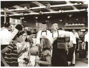 During the grand opening of the first Town & Country Market in 1957, box boys pack up groceries and children enjoy ice cream cones.