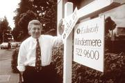 Windermere founder John Jacobi at a sold home in 1980. Two decades later, a family meeting helped him transfer power to the next generation.