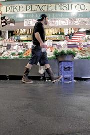 All the fish markets, including the Pike Place Fish Company, have new epoxy floors as part of the Pike Place Market renovation. The new floors are more leak-proof, durable and not as slippery as the old tile floors — particularly beneficial when creatures of the sea are being flung around.
