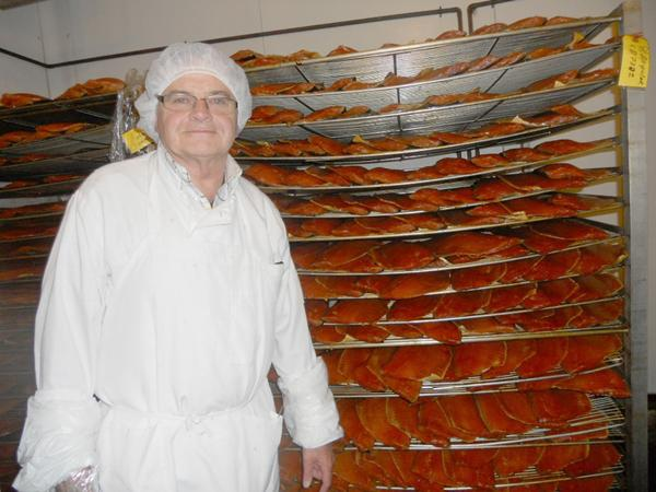 """Chef Dominique Place, of Gerard and Dominique Seafoods, is a little on the quiet side when it comes to the recipe for the company's smoked salmon. """"Salt, sugar, some spices,"""" he says, without elaboration."""