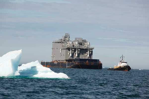 A high-strength barge from Crowley Maritime carries a 4,000-ton equipment module to an oilfield on Alaska's North Slope, where retreating sea ice offers access for more weeks of the year.