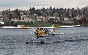 A Kenmore Air floatplane taxis to the dock after recently landing on Seattle's Lake Union. The city may restrict development in the booming South Lake Union neighborhood to preserve flight paths for floatplanes.