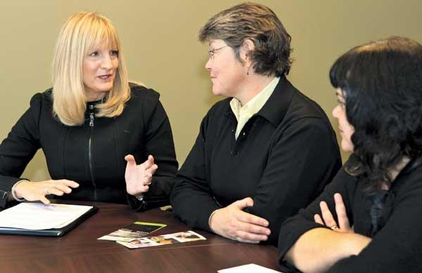 Paula Clapp (left), YouthCare Executive Director Melinda Giovengo (center) and Director of Development and Marketing Deborah Edison plan fundraising for StolenYouth.