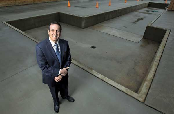 Janicki Industries President John Janicki stands above a concrete slab designed to hold an enormous 12-foot by 50-foot autoclave at his company's facilities in Hamilton, Wash. The company's headquartered in Sedro-Woolley.