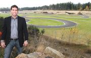 Jason Fiorito, president of Pacific Raceways, stands above the Kart track that Pacific Raceways lowered 30 feet to provide better noise abatement. Gravel removal continues behind the Kart Course where Pacific Raceways is building a second drag strip and hopes to add manufacturing.