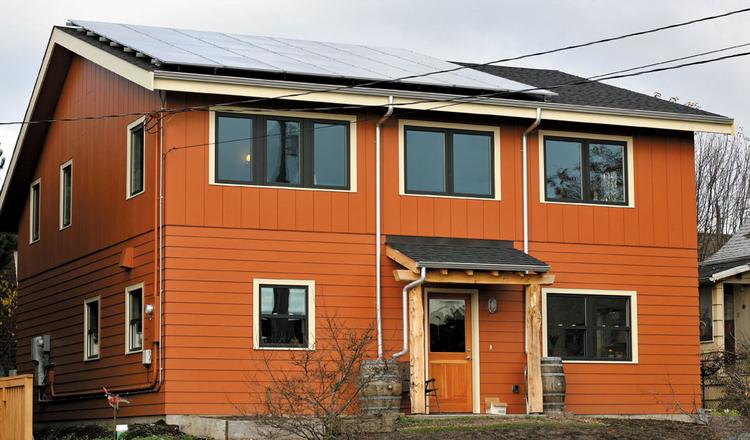 Eric Thomas and Alexandra Salmon built this house in Ballard. The roof has a solar  photovoltaic system that produces up to six kilowatt hours of electricity.