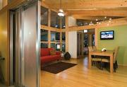 """A modular cottage from Seattle-based FabCab offers wide doorways for accessibility. """"We need an alternative to nursing homes and assisted living,"""" says FabCab principal Emory Baldwin."""