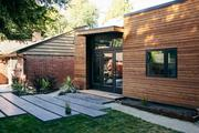 A 400-square-foot backyard cottage, at right, made by Seattle-based  Backyard Box, adjoins an older Seattle brick main home.