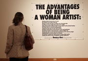 "Seattle Art Museum visitor Barbara Nepom of Seattle looks at a piece named ""The advantages of being a woman artist,"" by Guerrilla Girls, which is part of the ""Elles: Women Artists from the Centre Pompidou"" exhibit at the museum."