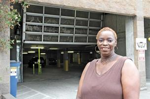"Angela M. Davis, a resident of SEED's Dakota apartments, likes her unit but has concerns about the building that include a key card-controlled security door to the parking garage (closeup below) that's often left in the open position. ""We shouldn't be tre"