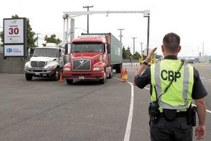 U.S. Customs and Border Protection officers scan a cargo container leaving the Port of Seattle Terminal 30 using a mobile X-ray  machine. The post-9/11 cargo system isolates a limited number of containers for screening.