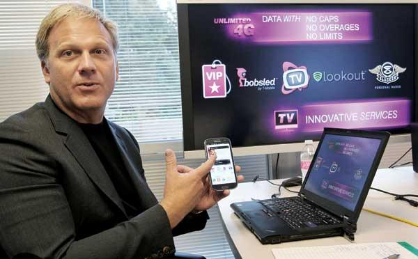 """POINT MAN: Brad Duea, T-Mobile senior vice president of product management, describes the Bellevue firm's unlimited data plan. """"Where most carriers are choosing to zig...we're choosing to zag..."""""""