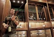 TARGET MARKET: Scott Weber, of Lake Stevens, looks over a shotgun in the Gun Library at Cabela's new store in Quil Ceda Village. The national retailer of outdoor gear is another anchor tenant for the Tulalip Tribes' growing retail and entertainment center near Marysville.