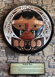 """CULTURE ON DISPLAY: Cabela's features a carving called """"Salish Sun"""" by Tulalip Tribes artist Joe Gobin."""
