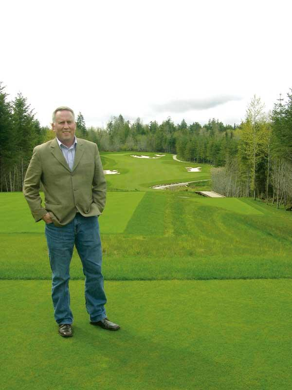 Ray Peters of the Squaxin Island Tribe stands at one of the holes of the new Salish Cliffs Golf Course near Kamilche. The tribe developed the course.