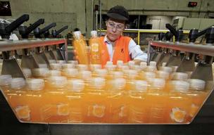 Candy Clark works quality assurance on the Sparkling Ice bottling line at the TalkingRain manufacturing facility in Preston. National demand for the brightly colored sparkling beverage has spurred TalkingRain to hire nearly 90 employees in the last 18 mon