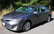 The 2014 Toyota Avalon Hybrid has a list price of $44.458, as pictured.