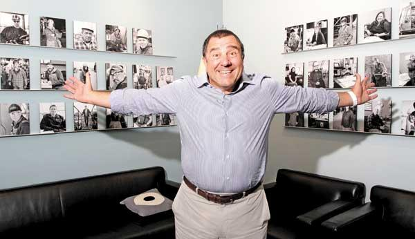 Frank Foti, CEO of Vigor Industrial, shows off his office's most prominent feature: a rotating photo collection of Vigor's 1,900 workers at seven Northwest shipyards. Seattle has become the epicenter of the company, which expects to hit $500 million in revenue this year.