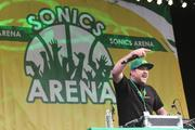 """DJ Indica Jones gets the crowd pumped up at a """"Bring back the Sonics"""" rally at Occidental Park in Seattle on Thursday."""